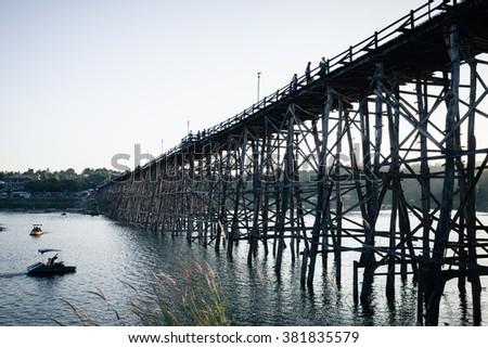 Utamanusorn Bridge (Mon Bridge), made from wooden for across the Stock photo © FrameAngel