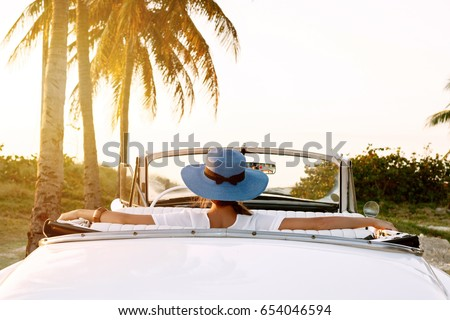 Palm tree. Beautiful woman on exotic Beach. Carefree young girl  Stock photo © Victoria_Andreas