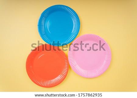 Empty white ceramic dish on over blue and pink background, squar Stock photo © CaptureLight