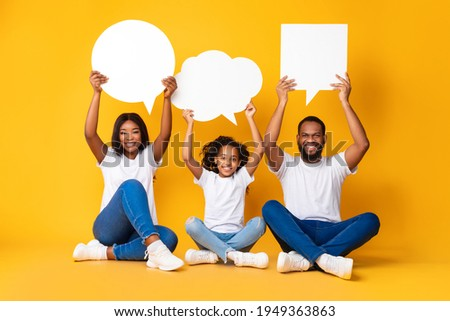 three happy women holding blank speech bubbles over their heads Stock photo © feedough
