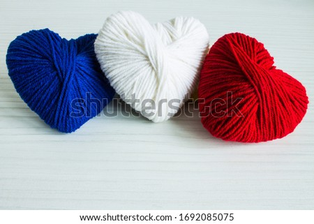 multicolored hearts with a balls of thread on blue wooden backgr stock photo © vlad_star