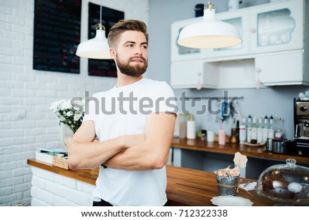Smiling waiter standing with arms crossed while friends dining in background Stock photo © wavebreak_media