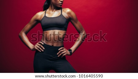 Midsection of fit athletes with hands on hip at fitness studio Stock photo © wavebreak_media