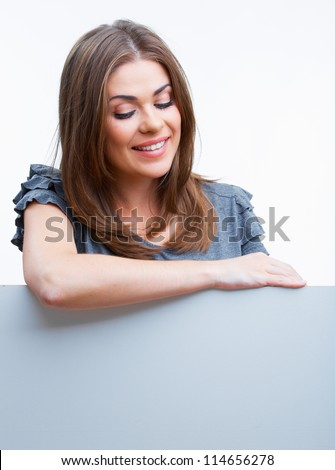 portrait of smiling businesswoman looking down at empty billboar Stock photo © feedough