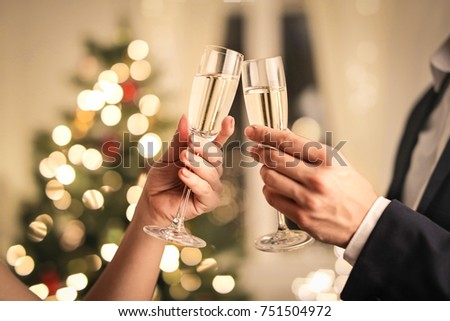 Woman and man with wine and presents in front of white Christmas tree Stock photo © Kzenon