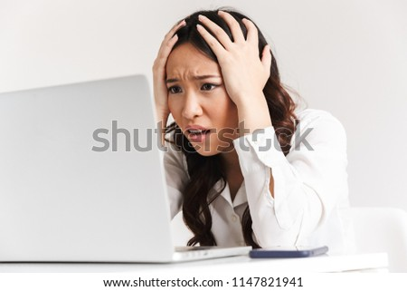 image of upset unhappy asian business woman 20s wearing office c stock photo © deandrobot