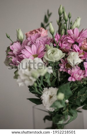 Bouquets of pink and white peonies presented on a gray concrete background in the form of a corner f Stock photo © artjazz