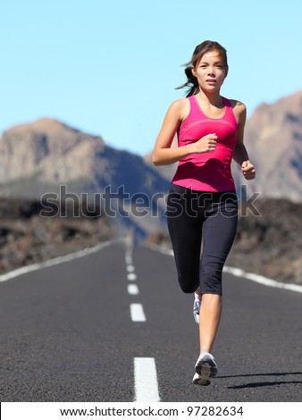 Stock photo: Female runner during outdoor workout in beautiful mountain natur