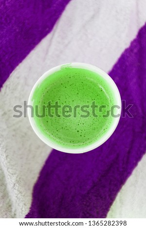 Glass with coffee on a striped beach towel. Abstract colors. Top Stock photo © TanaCh