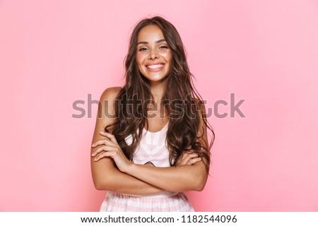 Image charmant femme 20s cheveux longs Photo stock © deandrobot