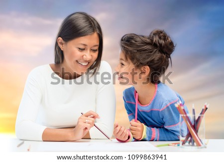 happy mother and daughter drawing over evening sky Stock photo © dolgachov