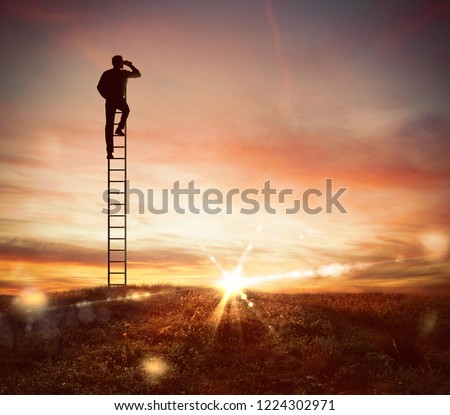 Businessman look far for new business opportunities with a telescope Stock photo © alphaspirit
