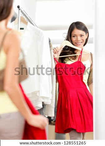 image of caucasian woman 20s wearing red dress smiling and eatin stock photo © deandrobot