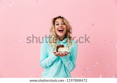 Photo of pretty woman in basic clothing holding piece of birthda Stock photo © deandrobot