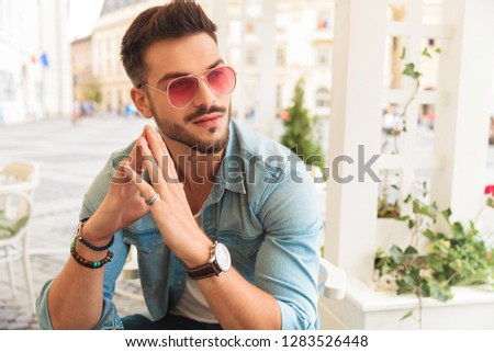 curious casual man wearing red sunglasses holding palms together Stock photo © feedough