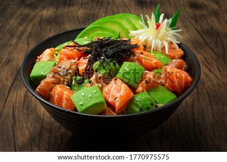 poke bowl with salmon and vegetables stock photo © karandaev