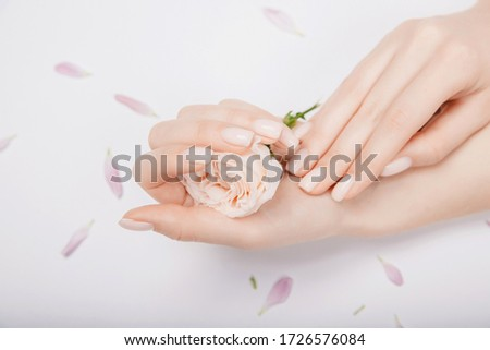 beautiful woman hands with pastel manicured nails isolated on a gray background copy space massage stock photo © artjazz