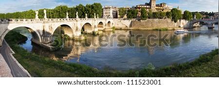 Ancient Ponte Sant Angelo stone bridge on Tiber river of Rome Stock photo © xbrchx