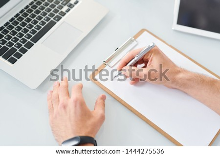 Stock photo: Young designer or economist with pen going to make notes or sketch