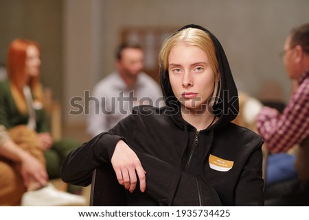 Young serious woman in casualwear looking for clothes of suitable size Stock photo © pressmaster