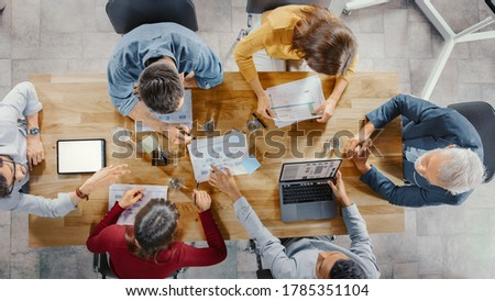 manager at the office making reports and statistics with blackboard background stock photo © ra2studio