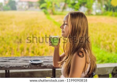 若い女性 カップ 緑茶 古い 木製のテーブル ストックフォト © galitskaya