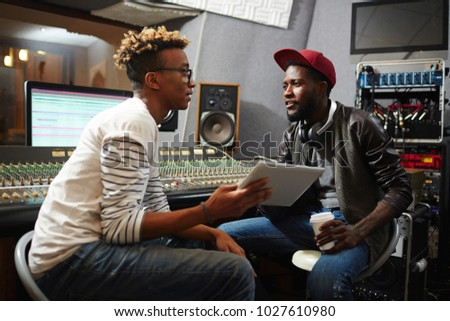 Young musician or producer showing African man group of sound waveforms Stock photo © pressmaster