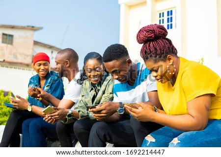 Happy friends using mobile phone and digital tablet at counter Stock photo © wavebreak_media