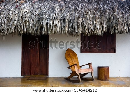Old wooden rocking chair by the old house in Santa Marta, Colomb Stock photo © boggy