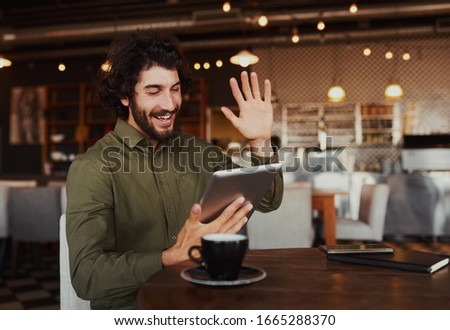 Casual young man with digital tablet communicating through video-chat Stock photo © pressmaster