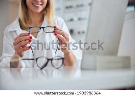 Pretty young client of optics shop or clinics sitting in front of clinician Stock photo © pressmaster