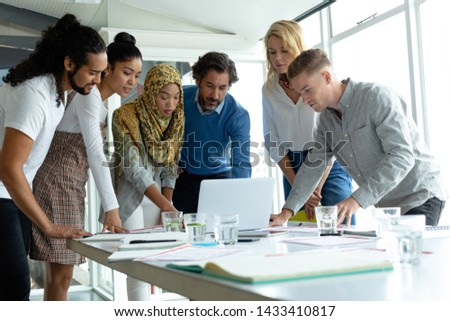 Front view of mixed-race young business people interacting with each others in office lobby Stock photo © wavebreak_media