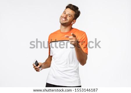 Satisfeito bonito masculino fitness instrutor indicação Foto stock © benzoix