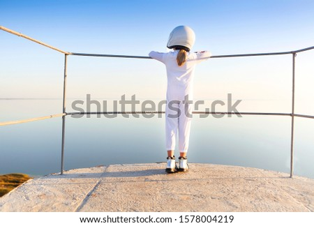Astronaut futuristic kid girl wearing white uniform and helmet Stock photo © dashapetrenko
