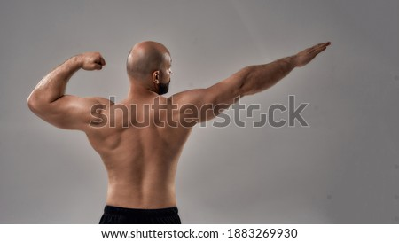 Health, bodybuilding and fitness concept. Rear view, handsome confident young caucasian guy, muscula Stock photo © benzoix