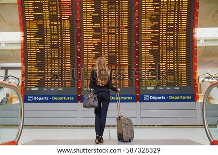 Young woman with her luggage at an international airport Stock photo © lightpoet