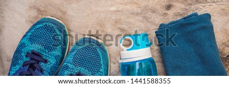 BANNER, LONG FORMAT Everything for sports turquoise, blue shades on a wooden background. Yoga mat, s Stock photo © galitskaya