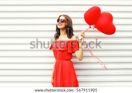 Beautiful girl in a red dress on a summer holiday. Stock photo © ElenaBatkova