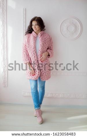 Fashion model woman in stylish tight denim pink shoes and pink wool coat Stock photo © ElenaBatkova