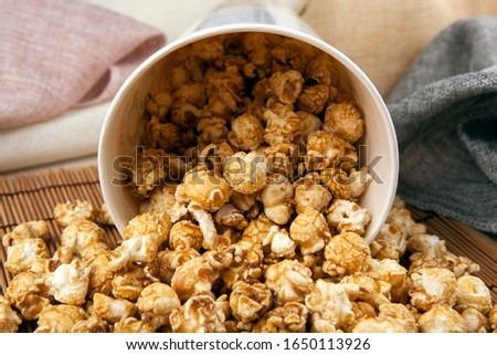 big cardboard cup with sprinkled sugar popcorn on a bamboo napki Stock photo © mizar_21984