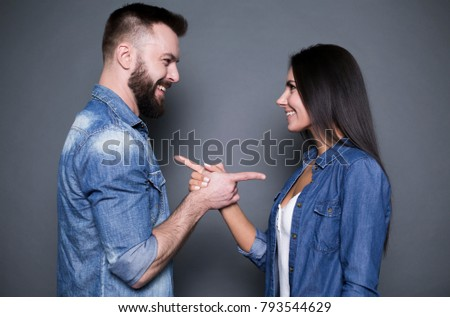 Young family couple embrace and look at each other with smile, wear jeans and warm sweaters, carry s Stock photo © vkstudio