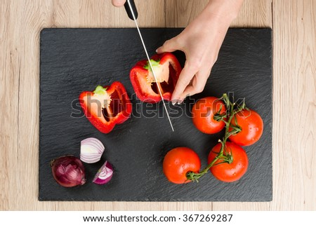 Top view of red sliced tomatoes on wooden chopping board. Sharp knife near. Green parsley and dill.  Stock photo © vkstudio