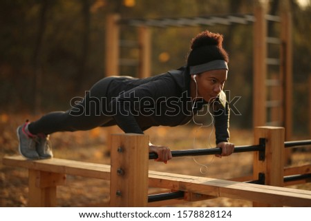 Image of african american sportswoman doing exercise with dumbbells Stock photo © deandrobot