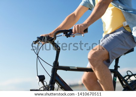 close up of man riding bicycle along summer beach Stock photo © dolgachov