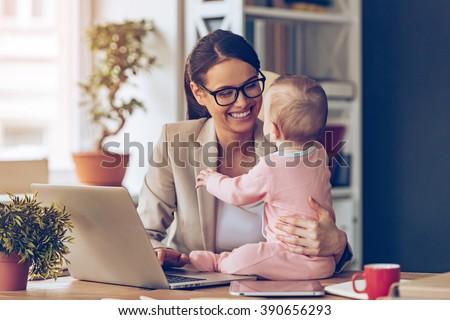 Intelligent female businesswoman working on laptop while analysi Stock photo © Freedomz