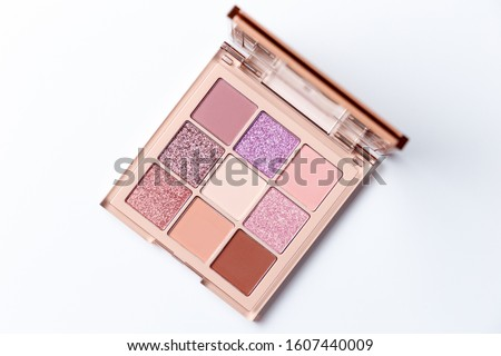 multicolored cosmetics eyeshadows in the box and brushes isolate stock photo © tetkoren