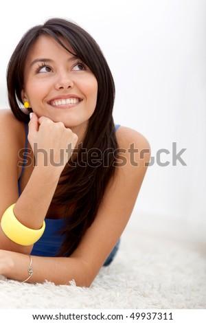 Happy and beautiful latin woman, lying on the floor, looking to camera, studio shot Stock photo © alexandrenunes