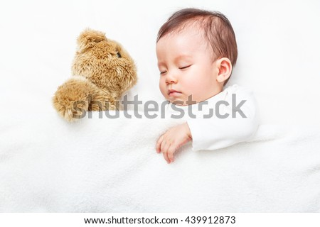 little baby girl play with her teddy bear toy new baby announcement card stock photo © balasoiu