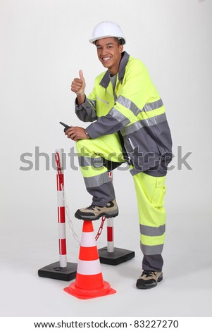 Studio portrait of a man in fluorescent work clothes and helmet Stock photo © photography33