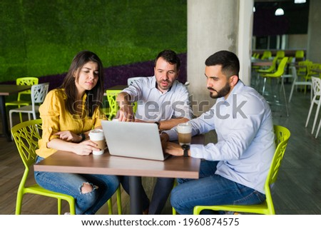 Happy man working on his laptop while having lunch in the kitchen  stock photo © wavebreak_media